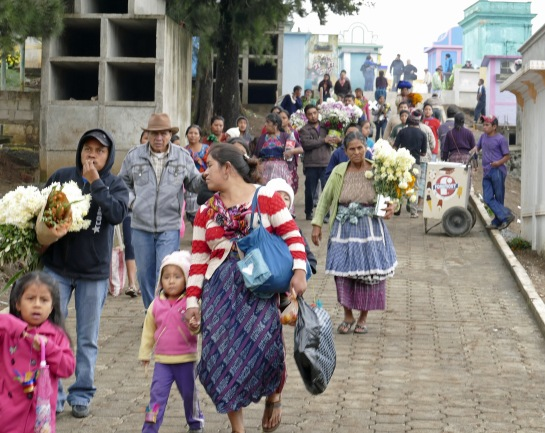 Families streaming into the cemetery
