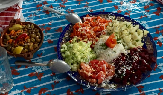 Beautiful salad of fresh cucumber, tomato, beets and